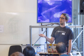 Louis Hoebregts speaking in front of an audience wearing a CodePen tshirt